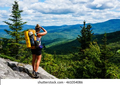 THE APPALACHIAN TRAIL, MAINE - CIRCA AUGUST 2015 - An Appalachian Trail Thru-Hiker looks back at New Hampshire just before she crosses into Maine, the last state of 14 on the trail.