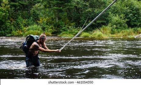 THE APPALACHIAN TRAIL, MAINE - CIRCA AUGUST 2015 - An Appalachian Trail Thru-Hiker fords a river in Maine.