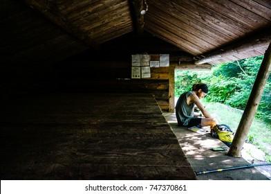 THE APPALACHIAN TRAIL IN PENNSYLVANIA - CIRCA JUNE 2015 - An Appalachian Trail Thru-Hiker takes a break for lunch at a shelter in Pennsylvania.
