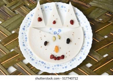 Appam/Palappam/Kallappam/vella appam/pancake, popular traditional Kerala breakfast bread and snack  Alappuzha, India. South Indian food. Fun food kids favourite kitty/king/clown/puppet/smiley shape.