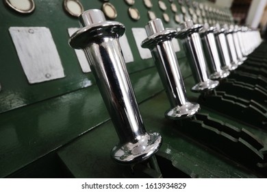 The apparatus of electro-latch centralization of arrows and signals for large railway stations in the first half of the 20th century, metal control levers