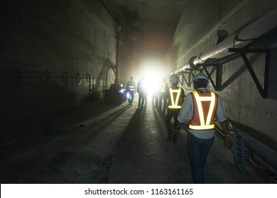 Apparent brightness of Yellow reflective light from safety vest in dark area