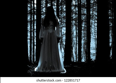 Apparitions of the female ghost in the mystical forest