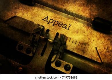 Appeal text on vintage typewriter