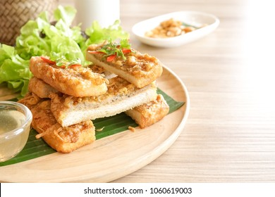 Appetizer. Asian appetizer of crispy shrimp sandwich or shrimp toast. Served with sweet plum sauce. Selective focus on the small bite of shrimp toast on the fork.