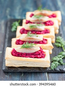 an appetizer with beet and herring