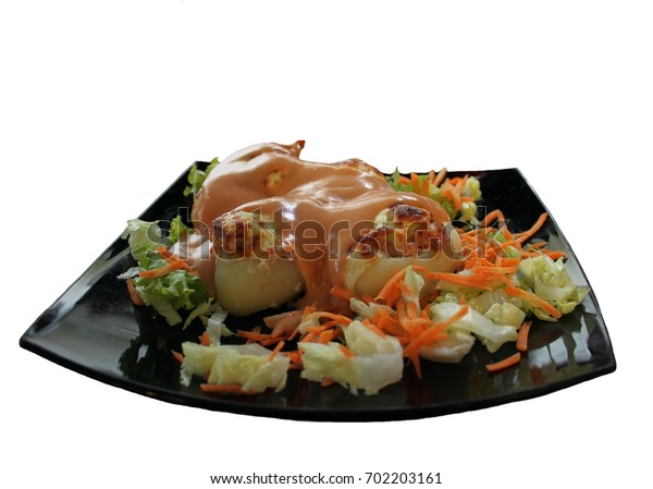 An appetizer called Potato slipper with potatoes baked with yellow cheese, decorated with carrots and cabbage