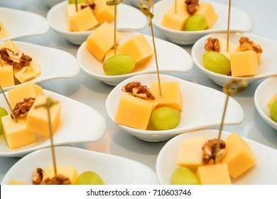 Appetizer of cheese cubes, grapes and walnut