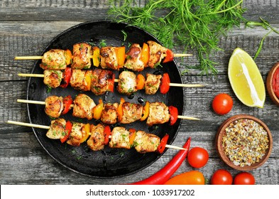 Appetizer chicken kebab with vegetables, top view