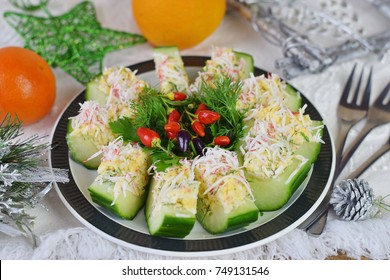 Appetizer from a fresh cucumber with crab meat, egg, cheese and dill. Christmas and New year concept