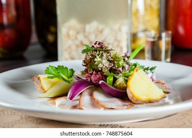 appetizer of meat, vegetables and potatoes on the table in the restaurant. the concept of food and celebration