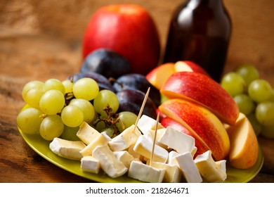 Appetizer mix including cheese, grape, plum and apple