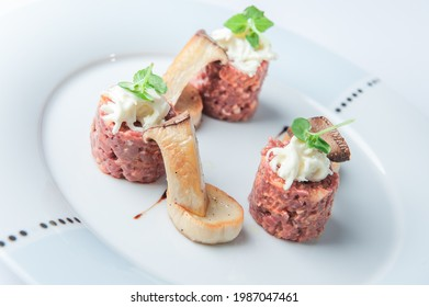 Appetizer with mushrooms and tarar - Shutterstock ID 1987047461