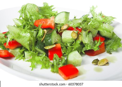 appetizer - salad with tomato and cucumber on white plate