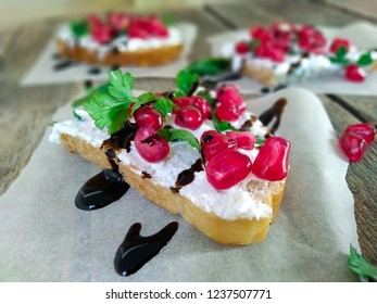 Appetizer / snack / sandwich cottage cheese, pomegranate and balsamic sauce. Ideas and recipes for a healthy breakfast, dinner. A tasty snack, perfect as an aperitif. Selective  focus.
