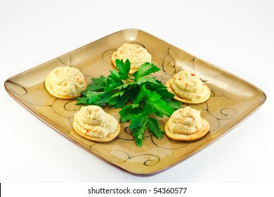 Appetizer spread made from cooked mashed chickpeas, mixed with tahini,olive oil, lemon juice , salt and garlic.