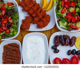 "appetizer table. The background consisting of salad, yogurt, olives, raw meatballs and appetizers.  Organic food background. isolated wooden background. ""haydari"""