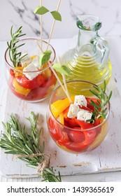 Appetizer. Vegetable salad: roasted bell pepper, two verrines on light background