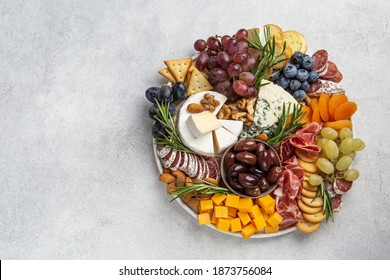Appetizers boards with assorted cheese, meat, grape and nuts. Charcuterie and cheese platter. Top view, copy space