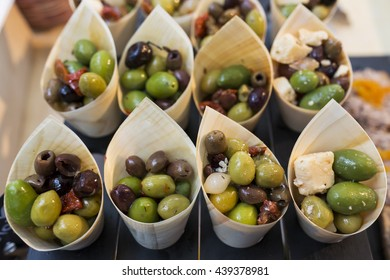 Appetizers from olives, tomatoes, garlic and cheese.