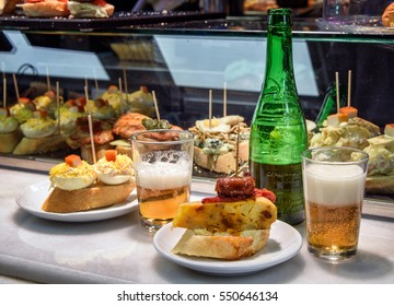 Appetizers served with beer at a Spanish tapas bar; selective focus
