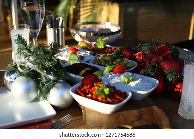 Appetizers and turkish raki on wooden table. Christmas with decorations.