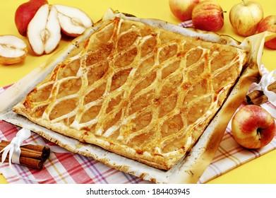 Appetizing apple pie on a baking sheet.