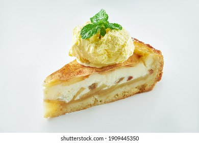 Appetizing apple pie pudding with vanilla ice cream isolated on white background. Close up, selective focus