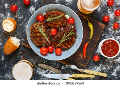 Appetizing barbecue steaks and a cool beer. An excellent picnic. Concept: eating in a cafe or outdoors. American food.