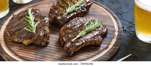 Appetizing barbecue steaks and light beer