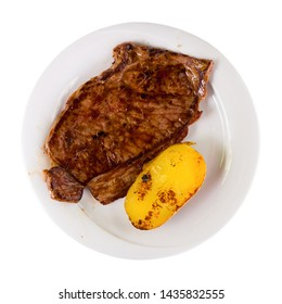 Appetizing beef steak with potatoes. Isolated over white background