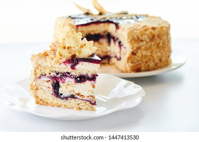 Appetizing berry cake on a white plate. Homemade pastries, sweet dessert for the holiday