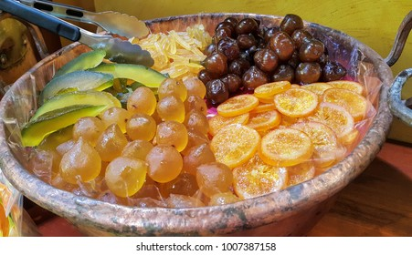 Appetizing candied fruit on a large platter, close-up