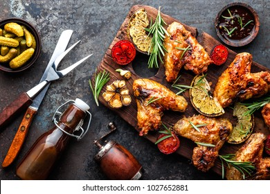 appetizing chicken wings grilled barbecue with spices and vegetables until crisp