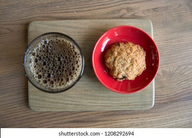 appetizing coffee and cookie on a wooden board top view