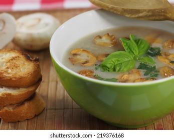 appetizing cream soup with champignon mushrooms