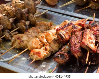 Appetizing delicious fried meat on a barbecue grill outdoors. Selective focus