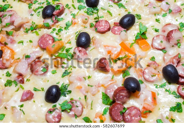 Appetizing delicious pizza with olives black olives close-up.
