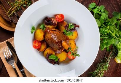 Appetizing duck confit with potato