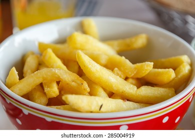 appetizing french fries potatoes in bowl, selective focus