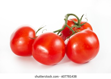 Appetizing, fresh tomatoes, red, firmly, just ripped from the bush, yet have a green twig - on a white background