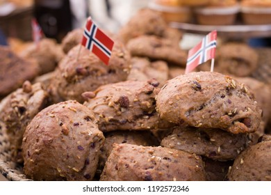 Appetizing, freshly baked Norwegian bread with the national flag of Norway. Celebration on May 17.