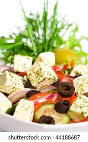 Appetizing greek salad. Close up.