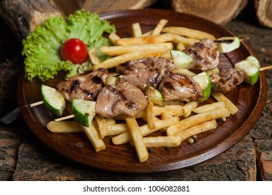 Appetizing grilled meat. Pieces of fried meat.