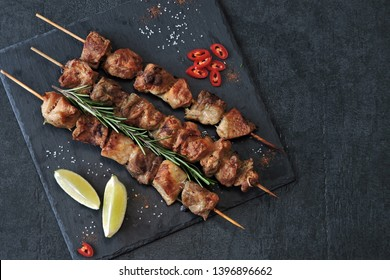 Appetizing kebab on wooden sticks. Keto Paleo. Pegan Diet.