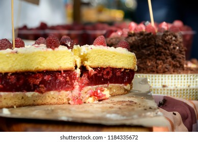 Appetizing raspberry pie with whole berries, homemade cakes, close-up