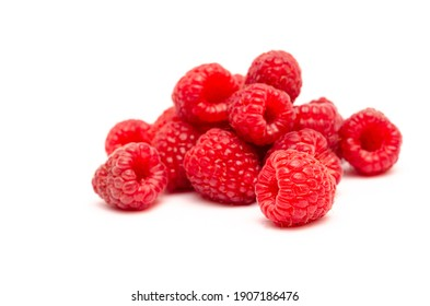 Appetizing red raspberry berries close up