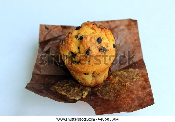 appetizing, ruddy, tasty vanilla muffin with chocolate pieces