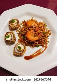 Appetizing shrimp yakisoba dish with hot Philadelphia and teriyaki sauce.
