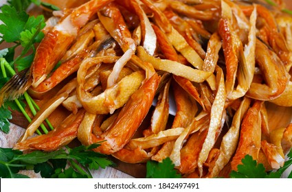 Appetizing slices of smoked salmon belly, russian cuisine